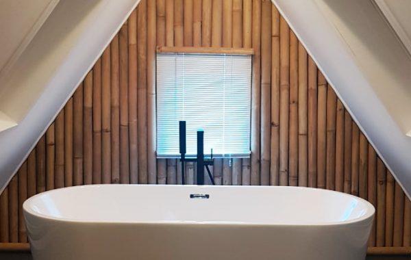 bagvæg badekar
